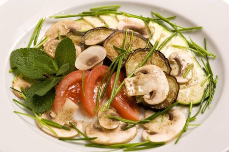 Vegetable salad with raw champignons. Healthy vegetarian food.