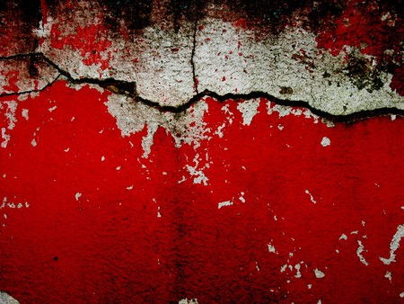 cracked bright red and white wall  photo