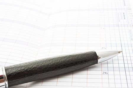 pen and open notebook to place your text photo