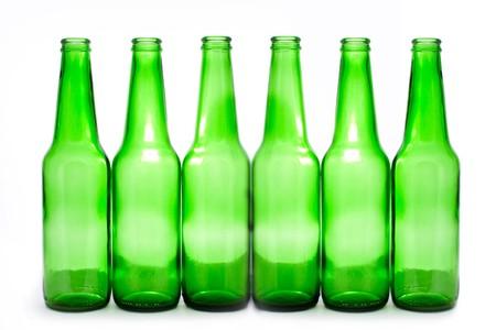 six green bottles isolated on white photo