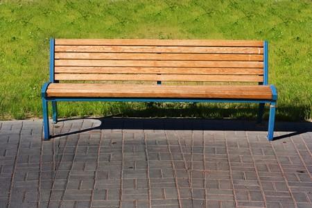 wooden bench over green grass photo