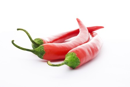 three red peppers isolated over white photo