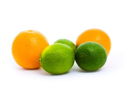 two oranges and limes isolated on white Stock Photo - 8122861