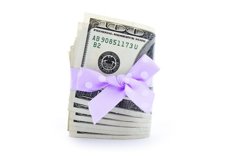 strapped: 100-dollar bills stack strapped with a beautiful ribbon Stock Photo