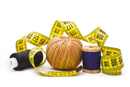 colorful thread with measuring tape isolated in white   photo