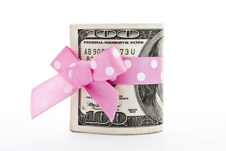 a stack of 100-dollar bills with a holiday bow isolated on white Stock Photo - 8165531