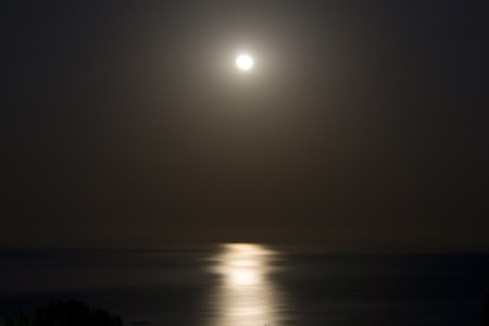 moon reflected in the sea in the night Stock Photo - 8196379