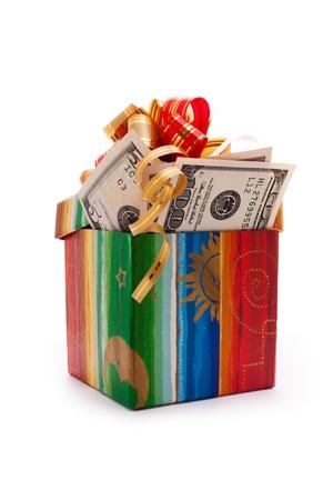 gift box full of dollar bills isolated on white Stock Photo - 8467817