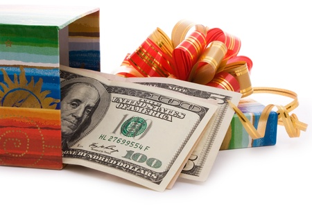 wrapped present: close up shot of gift box full of dollar bills isolated on white  Stock Photo