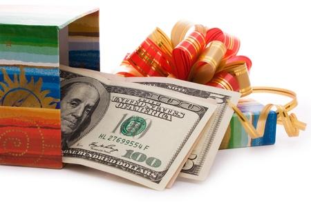 money box: close up shot of gift box full of dollar bills isolated on white  Stock Photo