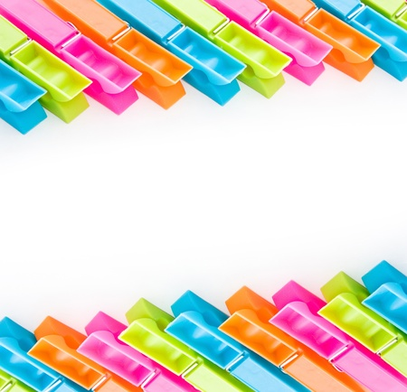 close up shot of multicolored clothespins isolated on white photo
