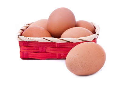 eggs in a wicker red basket on white background  photo