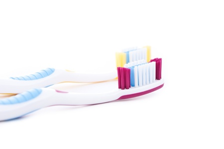 tidiness: red and yellow toothbrushes isolated on white background