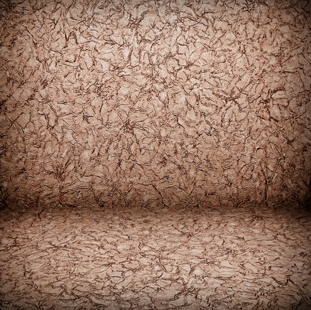 creative brown abstract background made of crumpled paper texture with artistic shadows added photo