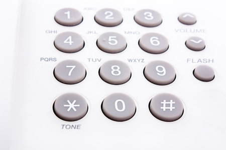 close up shot of grey and white phone keypad  photo