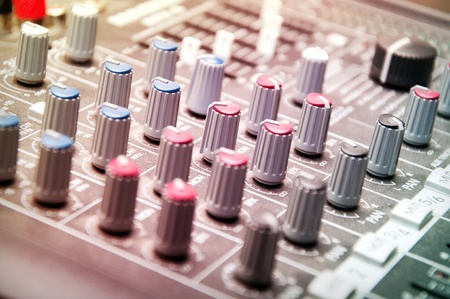 close up shot of sound mixer in studio  photo