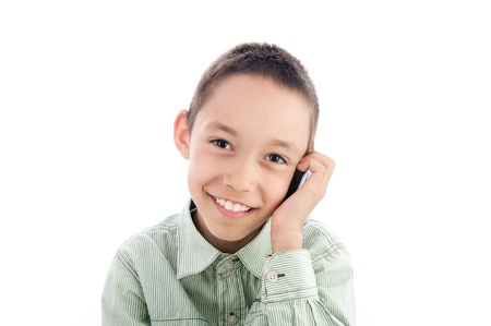 young boy calling on the cellphone isolated on white  photo