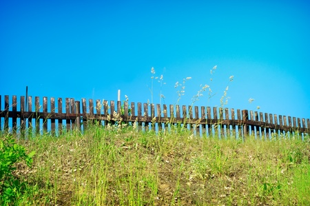 Wooden fence on pasture in nice sunny day  photo