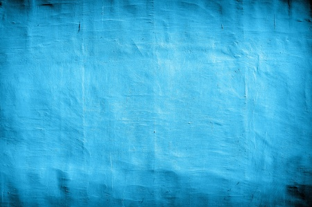 vintage blue wall as background with artistic shadows added photo