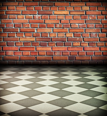 creative vintage interior with brick wall and chess tile floor photo