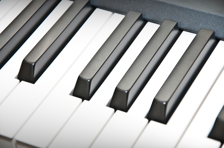 keyboard player: Close up shot of black & white piano keys