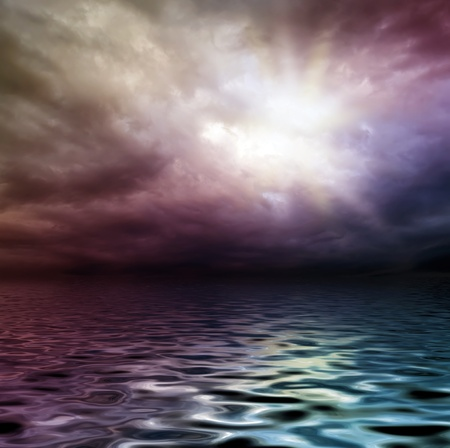 dark storm sky over water surface with artistick shadows added photo