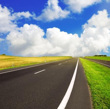 non marking: asphalt road over blue sky - travel concept