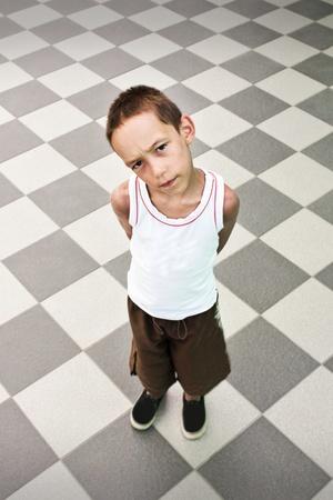 alone sad: suspicious boy standing alone over black and white background