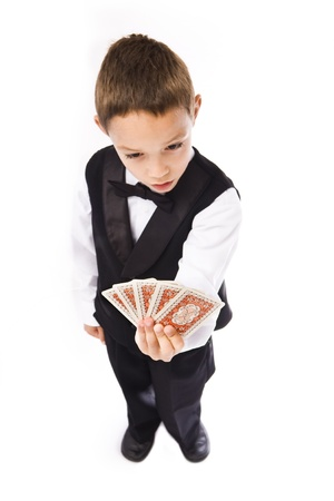 games hand: boy playing pocker isolated over white