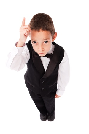 young boy raising his finger up isolated on white photo
