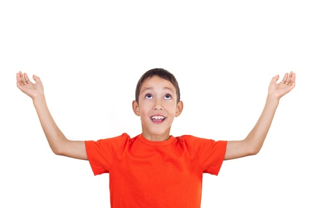 above head: boy with his hands raised up isolated on white background