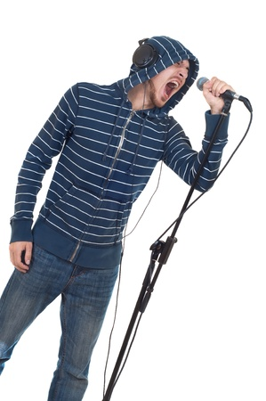 feeling up: rock singer with his mouth open screaming in microphone isolated on white Stock Photo