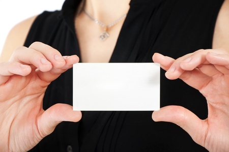 Woman hand holding white empty blank business card, shallow DOF photo