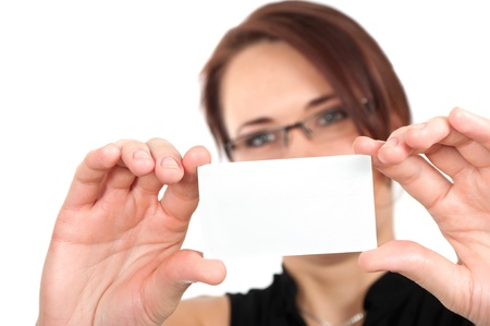 Woman hand holding white empty blank business card, shallow DOF, face in blur  photo