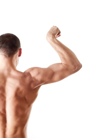 back view of a muscular young man showing his biceps isolated on white photo
