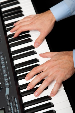closeup shot of male hands playing the piano in the studio Stock Photo - 11088285