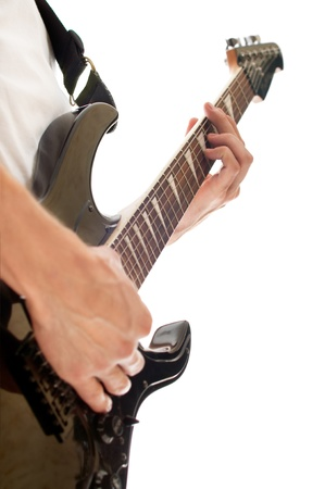 close up shot of male hand playing electric guitar isolated on white  Stock Photo