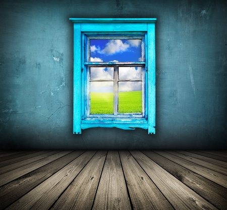 dark vintage blue room with wooden floor and window with field and sky above it  Stock Photo