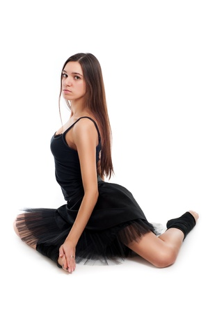 female ballet dancer in black dress with beautiful healthy brown long hair lying on white background  photo
