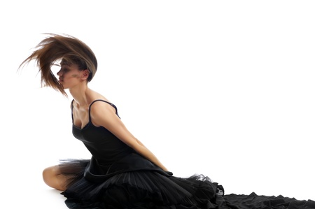 dynamic shot of a female ballet dancer shaking her hair and throwing it back isolated on white background photo