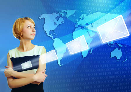 young woman over world map sending email message via internet - social network and technology concept Stock Photo - 12373227