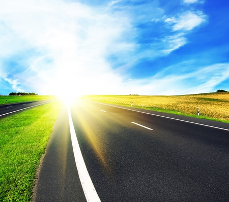 asphalt road over blue sky - travel concept