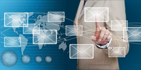 businesswoman hand pressing email letter on a touch screen interface Stock Photo - 13487406