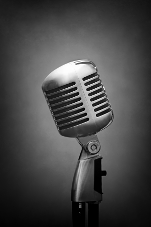 vocal: retro vocal studio microphone over grey background with shadows added Stock Photo
