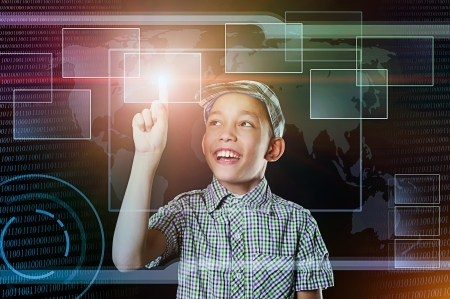 young boy touch virtual button in multicolored web inteface Stock Photo - 19244529