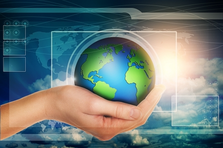 hand holding earth globe in blue virtual interface with clouds Stock Photo - 19288285