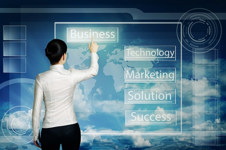 business woman push virtual icon in web interface over blue cloudy sky photo