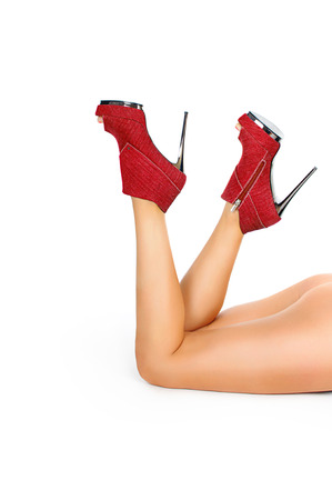 sexy slender female legs in  red high heels isolated on white background photo