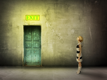 way out: young woman in black and white dress stand in front of blue door in dark grungy room watch on glowing exit sign - find the way out
