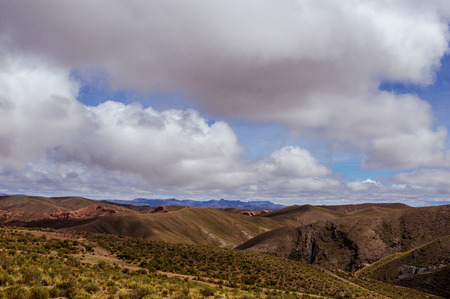 Mountains of Bolivia, altiplano, desert and green landscapes, trees and rocks, sand and water, sky and earth. Beautiful views of South America. photo
